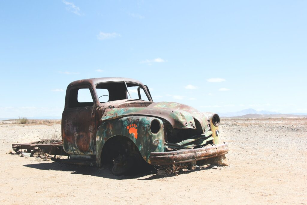 wrecked single cab pickup truck on field